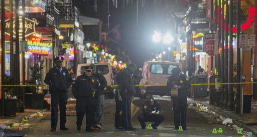 New Orleans Police Department investigators study a crime scene after a fatal shooting in New Orleans, Sunday, Nov. 27, 2016. (Matthew Hinton/The Advocate via AP)