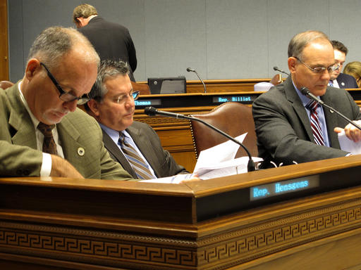 """Reps. Bob Hensgens, R-Abbeville; Jerome """"Zee"""" Zeringue, R-Houma; and Tony Bacala, R-Prairieville, from left to right, look through budget documents, on Wednesday, Dec. 7, 2016, in Baton Rouge, La. The House Appropriations Committee has been holding hearings about how agencies are spending their money this year and what they're requesting next year. (AP Photo/Melinda Deslatte)"""