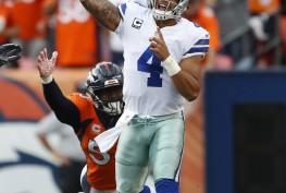 Dallas Cowboys quarterback Dak Prescott(4) throws as Denver Broncos outside linebacker Von Miller pursues during the second half of an NFL football game, Sunday, Sept. 17, 2017, in Denver. (AP Photo/Joe Mahoney)