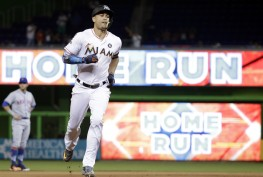 Miami Marlins' Giancarlo Stanton runs the bases after hitting a three-run home run during the fourth inning of a baseball game against the New York Mets, Monday, Sept. 18, 2017, in Miami. (AP Photo/Lynne Sladky)