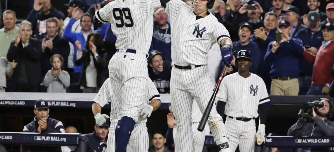 New York Yankees' Aaron Judge (99) celebrates with Gary Sanchez after hitting a two-run home run during the fourth inning of the American League wild-card baseball game against the Minnesota Twins on Tuesday, Oct. 3, 2017, in New York. (AP Photo/Frank Franklin II)