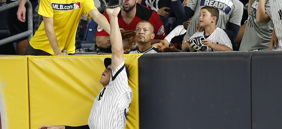New York Yankees right fielder Aaron Judge makes a catch at the wall on a line drive hit by Cleveland Indians' Francisco Lindor during the sixth inning in Game 3 of baseball's American League Division Series, Sunday, Oct. 8, 2017, in New York. (AP Photo/Kathy Willens)