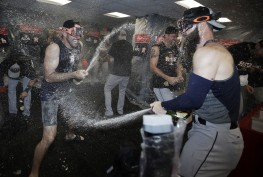 ADDS PLAYER'S NAME - Houston Astros pitcher Justin Verlander, left, celebrates in the clubhouse with teammates after eliminating the Boston Red Sox with a 5-4 victory in Game 4 of baseball's American League Division Series, Monday, Oct. 9, 2017, in Boston. (AP Photo/Charles Krupa)