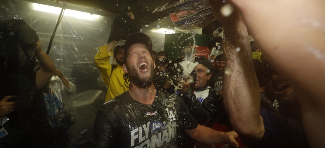 Los Angeles Dodgers' Clayton Kershaw and his teammates celebrate after Game 5 of baseball's National League Championship Series against the Chicago Cubs, Thursday, Oct. 19, 2017, in Chicago. The Dodgers won 11-1 to win the series and advance to the World Series. (AP Photo/Matt Slocum)